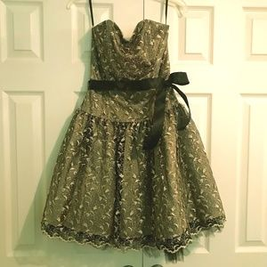 Short semi-formal black and gold dress